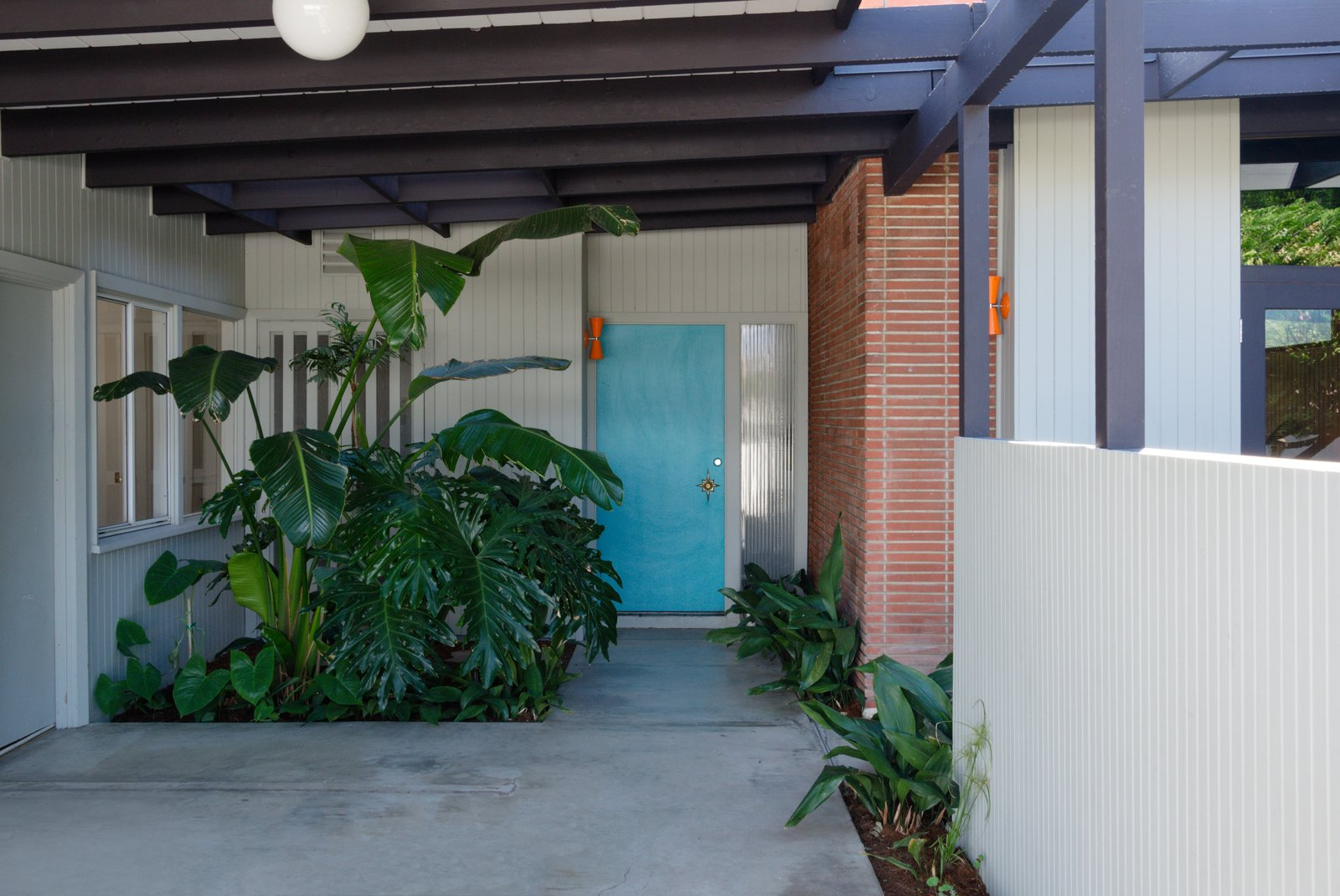 Exterior, Wood Siding Material, House Building Type, Brick Siding Material, Flat RoofLine, and Mid-Century Building Type The post-and-beam construction was designed for indoor/outdoor living and has been perfectly preserved over the years, with only two owners.     Photo 2 of 17 in Snag This Hollywood Hills Midcentury Home For $1M