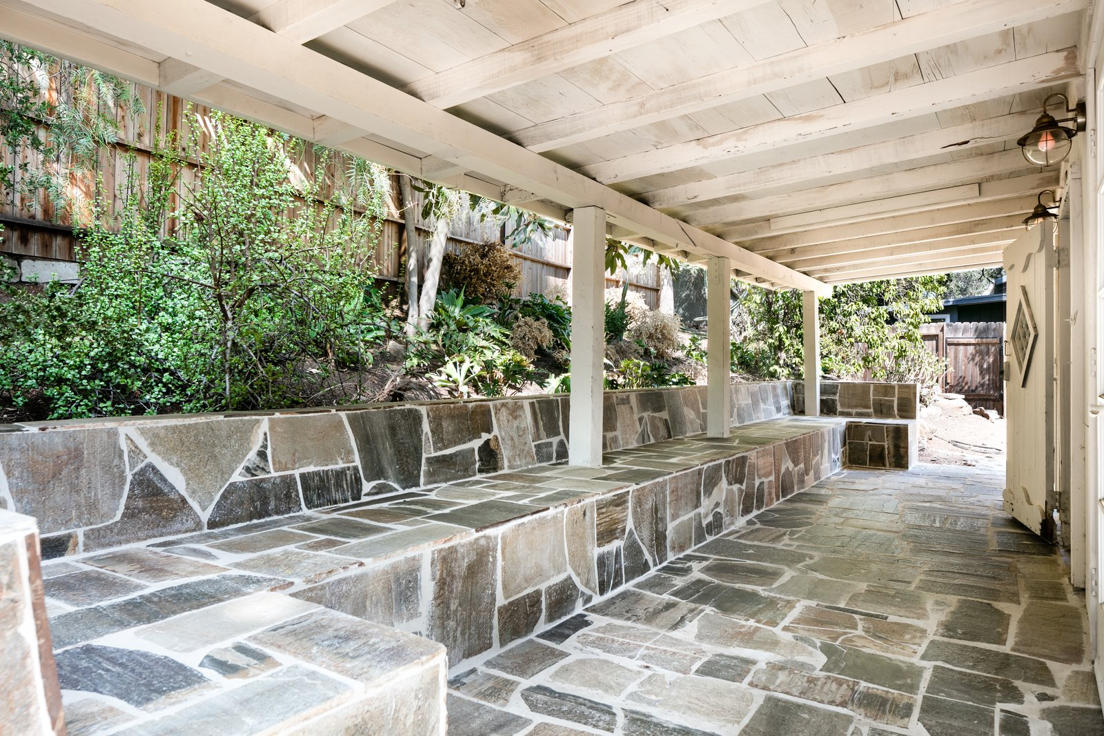 Outdoor, Stone Patio, Porch, Deck, and Small Patio, Porch, Deck A peek at the stone patio.     Best Photos from Leanne Ford's Vintage Echo Park Cabin Hits the Market at $995K