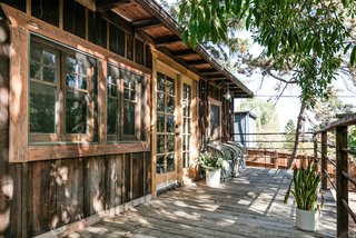 The cabin's charming front porch makes it hard to believe the property is located in the heart of Los Angeles.