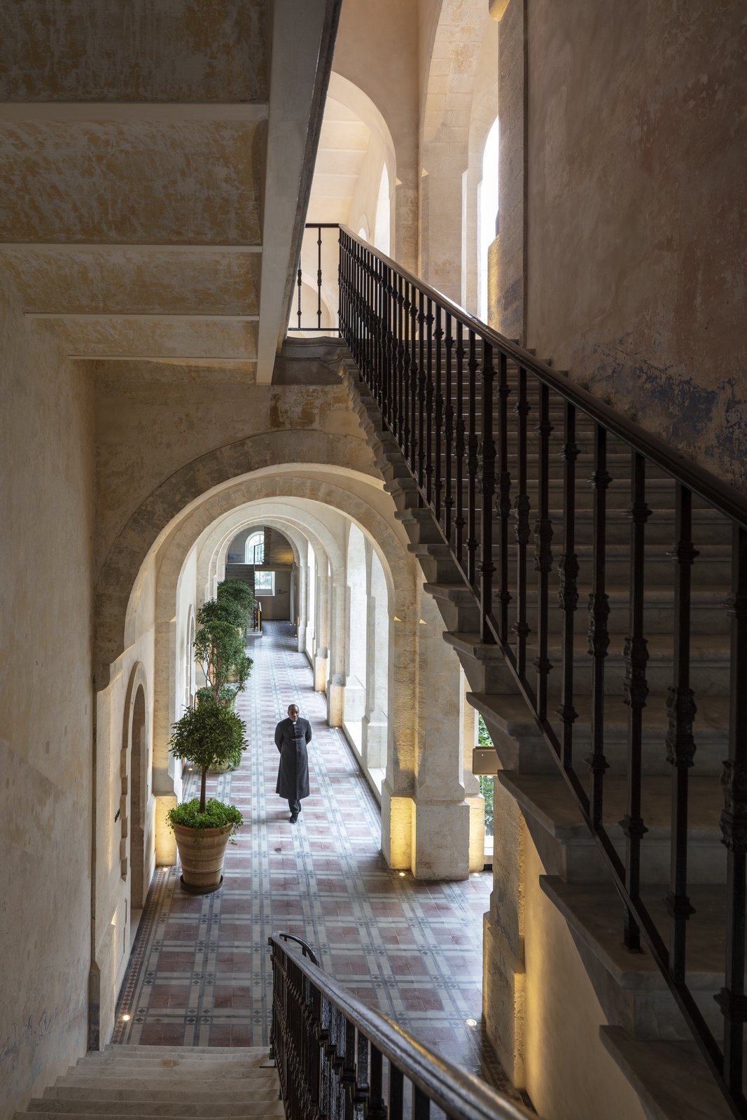 Staircase, Metal Railing, and Stone Tread Restored elements include stucco and stonework that date back to the 12th century.  Jaffa Hotel from John Pawson Turns an Old Hospital and Convent Into a Luxe Hotel in Israel