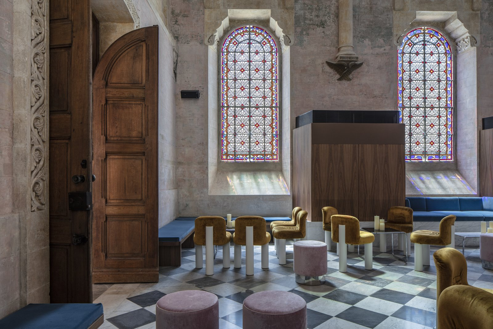 Living Room, Chair, Table, Stools, and Bench Gorgeous golden-yellow Cini Boeri Botolo chairs pair perfectly with the chapel's neutral palette and high ceilings.  Jaffa Hotel from John Pawson Turns an Old Hospital and Convent Into a Luxe Hotel in Israel