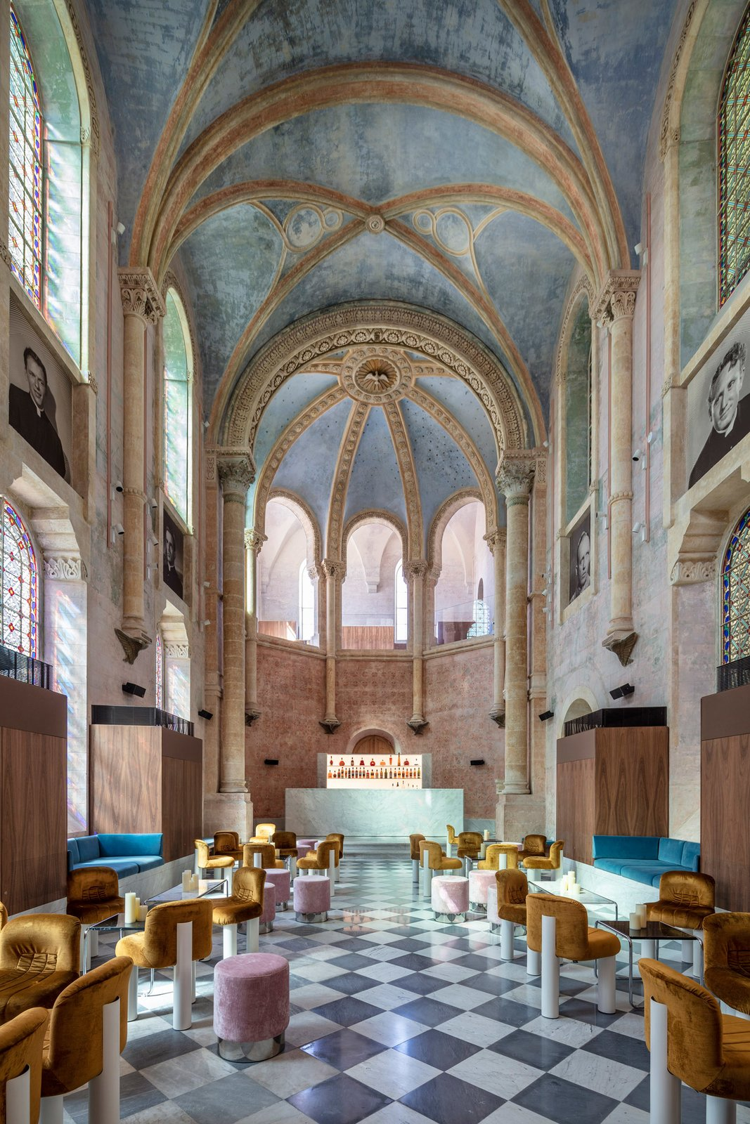Living Room, Chair, Wall Lighting, and Stools A peek at the striking contemporary lounge bar located in the historic 19th-century chapel.  Jaffa Hotel from John Pawson Turns an Old Hospital and Convent Into a Luxe Hotel in Israel