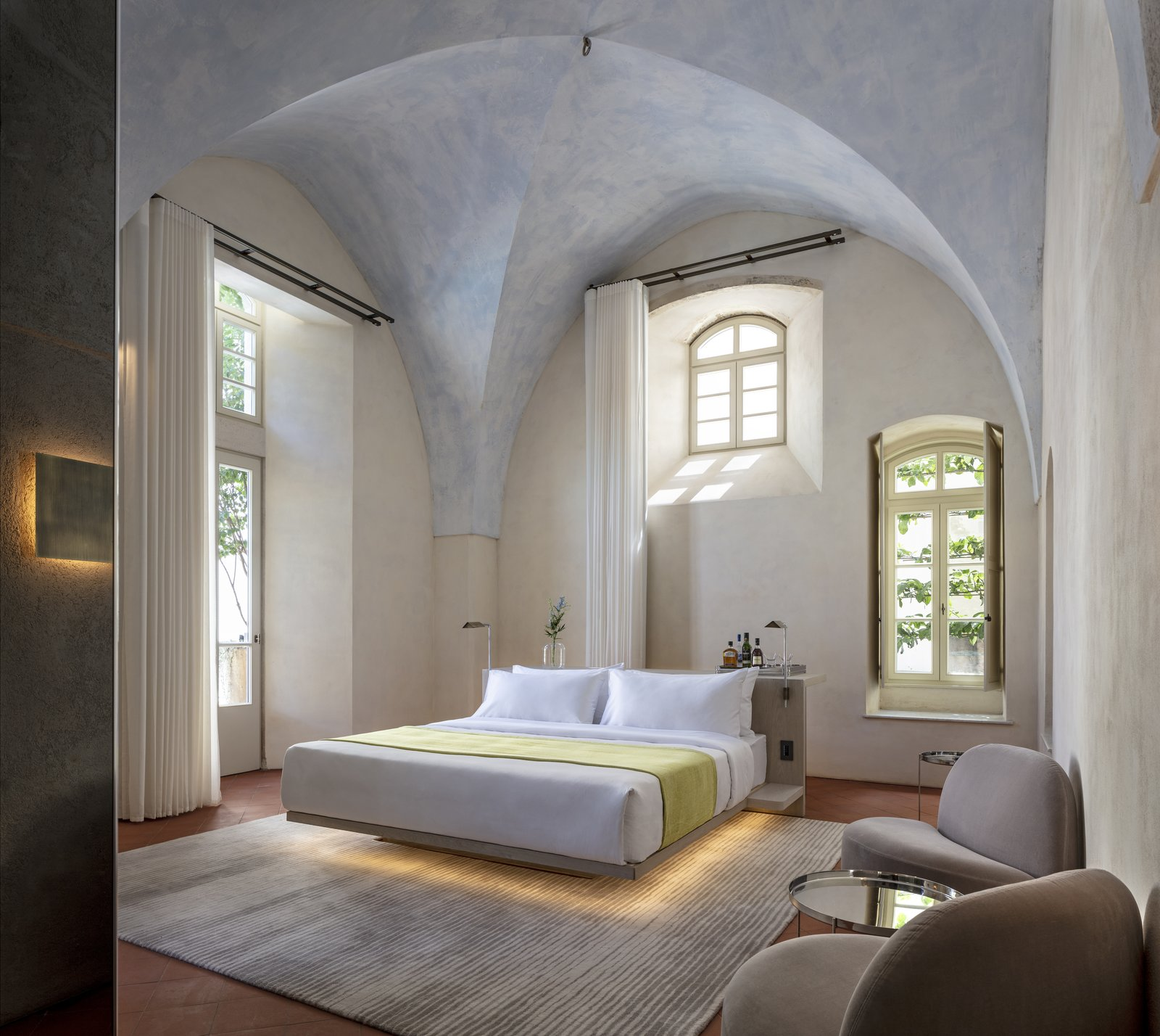 Bedroom, Chair, Rug Floor, Wall Lighting, and Bed The rooms boast the same contemporary yet historic feel. This is the Jaffa Room.   Jaffa Hotel from John Pawson Turns an Old Hospital and Convent Into a Luxe Hotel in Israel