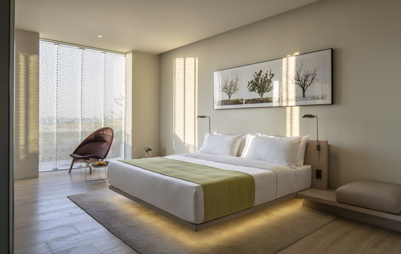 Bedroom, Wall Lighting, Chair, Bed, Rug Floor, and Bench The bedroom of the Presidential suite.  Jaffa Hotel from John Pawson Turns an Old Hospital and Convent Into a Luxe Hotel in Israel