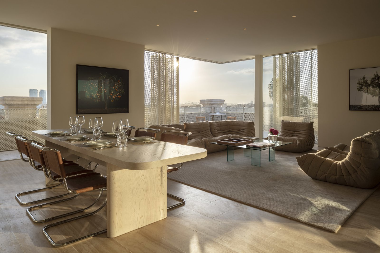 Living Room, Chair, Table, Coffee Tables, Sofa, Rug Floor, and Recessed Lighting The stylish Presidential suite features a sofa and chairs from Lignet Roset.  Jaffa Hotel from John Pawson Turns an Old Hospital and Convent Into a Luxe Hotel in Israel