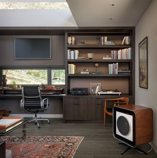We can't dream up more perfect home office ideas for him. Handsome paint colors combine with dark wood cabinetry and hardwood floors to create this masculine-leaning office in a renovated midcentury home in Southern California. The homeowner scoured high and low for this 1956 Quadreflex mono speaker designed by Charles and Ray Eames for Stephens Tru-Sonic—the ultimate grown-up toy.
