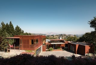 The hillside home is nestled into its surroundings and enjoys breathtaking views of Mt. Diablo.