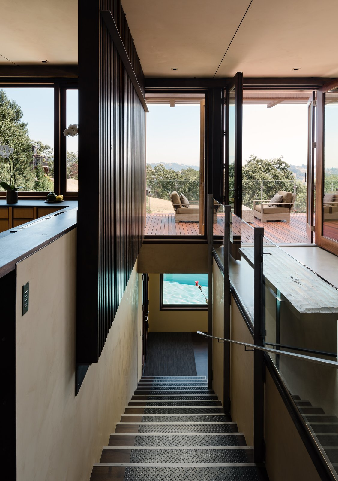 Staircase, Metal, Wood, and Metal Stairs provide a smooth transition to the lower level.  Staircase Wood Metal Metal Photos from Own Award-Winning Architect Greg Faulkner's Home For $4.9M