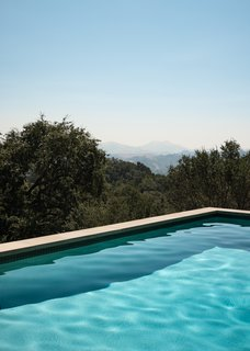 The solar-heated pool and spa enjoys spectacular scenery.