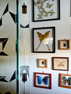 The geometric tiles play with abstraction and scale, riffing off a more literal interpretation of the client's butterfly collection.