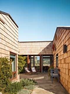 The courtyard sits in the center of the home and divides it into two wings, separating the family's private quarters from the guest accommodations.  There are almost no hotel rooms in Stinson Beach, so being able to spend the night is exceptionally special.