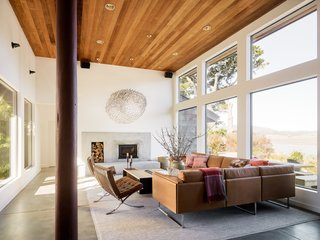 The influence of the beach is echoed in the living room's sandy, stucco masonry. A wall of windows brings a sense of the outside in.