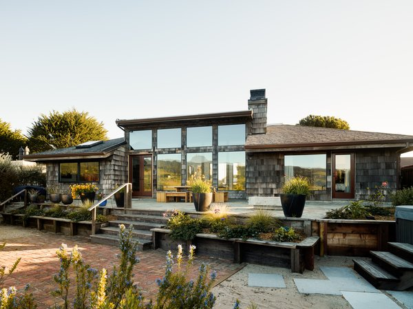 The Inlet House exterior is marked by cedar shingle wood siding and ample glazing that emphasizes the views and the feeling of living in a wildlife sanctuary.