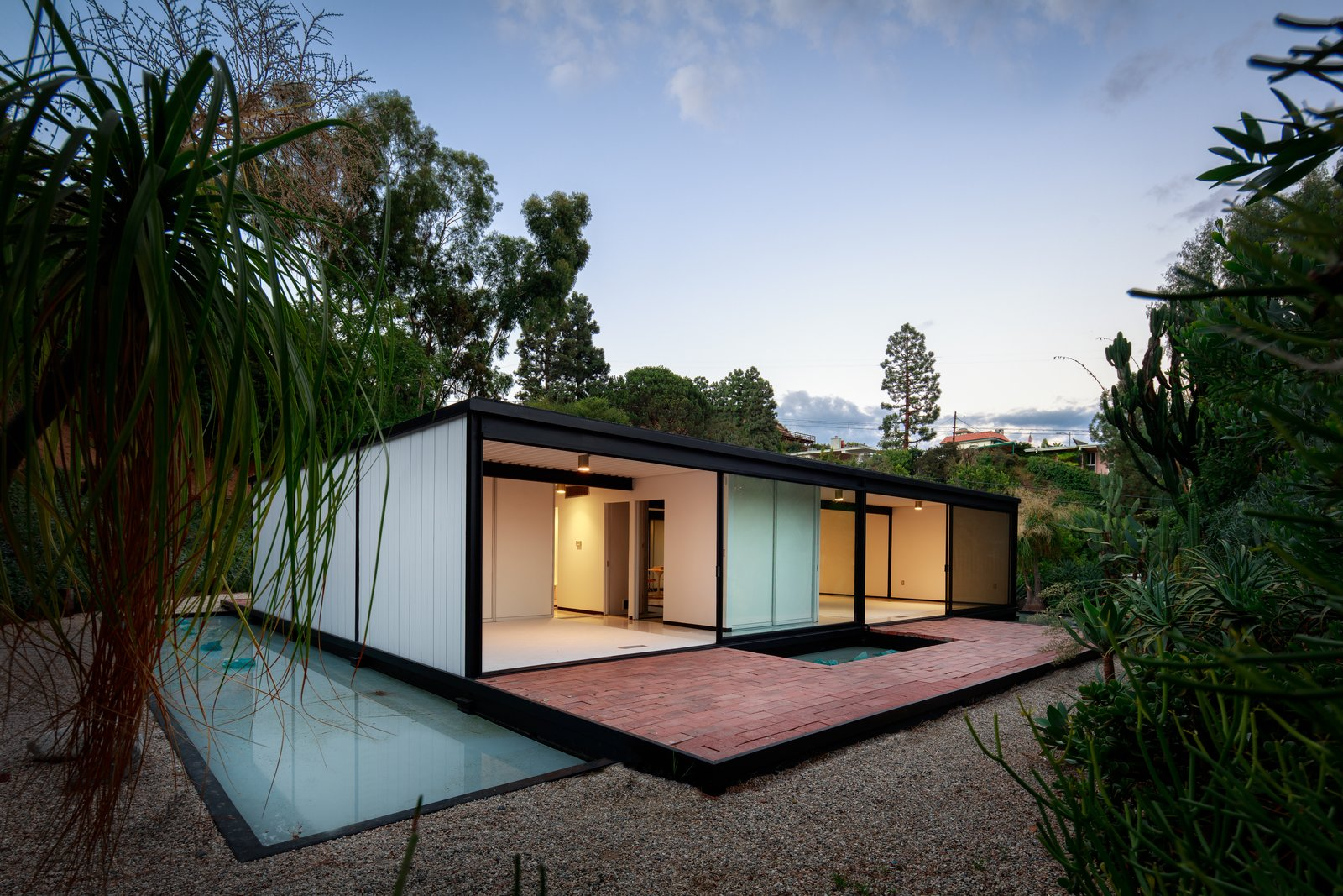 Exterior, Mid-Century, Flat, Metal, Glass, and House The deceptively simple design makes it a well-recognized masterpiece of midcentury design.   Best Exterior Metal Mid-Century Flat Photos from This Pierre Koenig-Designed Case Study House Lists For $3.6M
