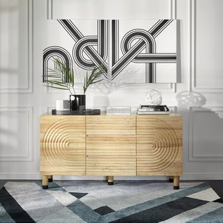 "The Josef Sideboard Buffet in blonde wood is part of the ""New Neutrals."""