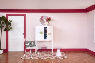 "The Eye-Con Bar Cabinet is part of the cheeky ""Wink of Pink"" collection."