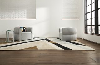 A pair of Cloud Club Chairs in empire ice with a Milan Collection area rug make a chic and graphic modern statement.