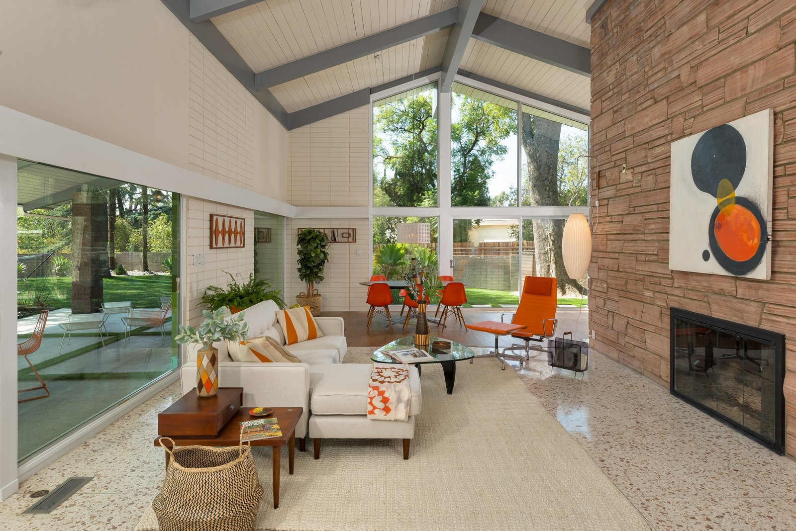 Living, Terrazzo, Table, Rug, Coffee Tables, End Tables, Two-Sided, Chair, Wood Burning, and Sofa Here is a peek of the living area. There is an additional sitting area just around the corner.      Living Table Two-Sided Photos from Step Back in Time in This Midcentury Now Asking $1.4M