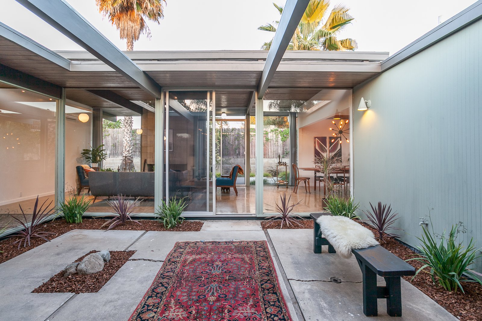 Outdoor, Gardens, Walkways, Concrete, Small, Vertical, Hanging, Hardscapes, Wood, and Side Yard The lovely central atrium.  Best Outdoor Hanging Side Yard Photos from An Updated Eichler With an Indoor-Outdoor Master Bath Seeks $1.15M