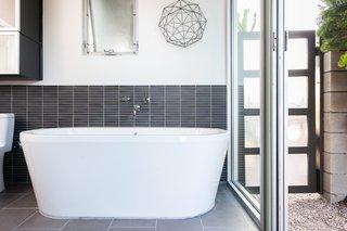 Sliding doors can be opened for a true indoor-outdoor feel.