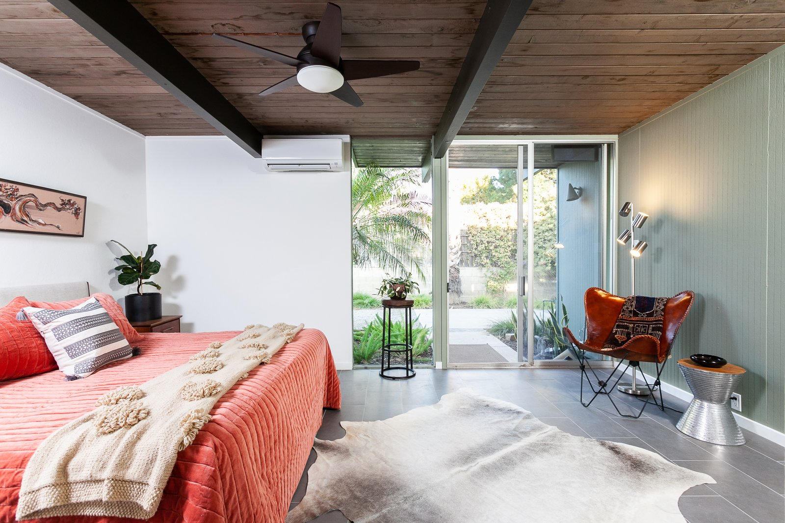 Bedroom, Bed, Rug, Ceiling, Night Stands, Floor, Lamps, Porcelain Tile, and Chair The master bedroom has French doors which lead to the outside.  Best Bedroom Bed Porcelain Tile Ceiling Photos from An Updated Eichler With an Indoor-Outdoor Master Bath Seeks $1.15M