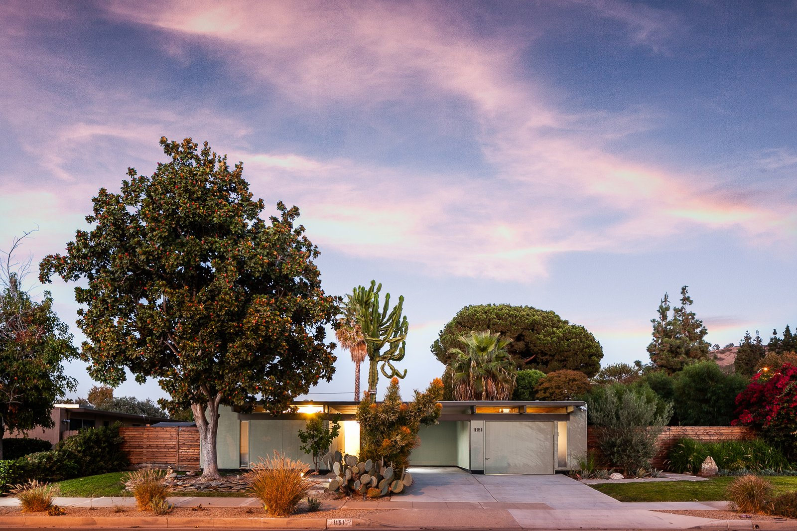 Exterior, Wood, Flat, Brick, Mid-Century, Glass, House, and Metal The flattop Eichler at dusk.  Best Exterior Glass Brick Wood Photos from An Updated Eichler With an Indoor-Outdoor Master Bath Seeks $1.15M