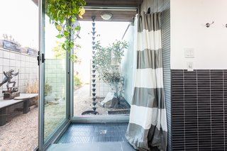 The indoor-outdoor shower.