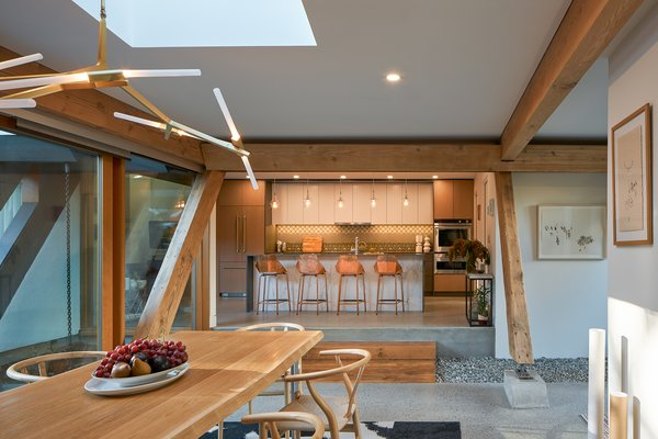 A skylight was added over the dining table to further increase the amount of natural lighting. A bridge between new and old was created by using the timber from a beam that was removed where the kitchen opens to the dining area.