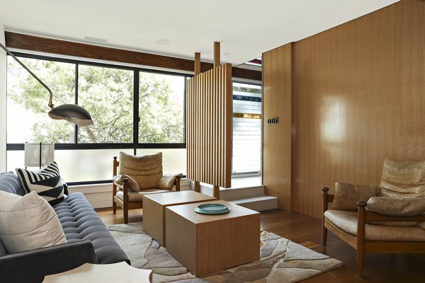 Wood paneling is found throughout the home, creating an authentic midcentury vibe.