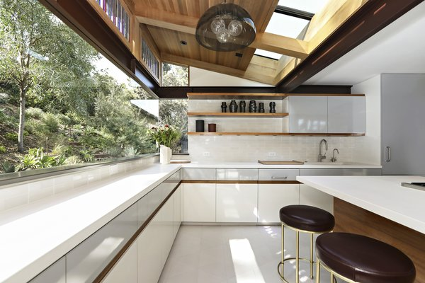 The updated kitchen is bright and airy thanks to expansive glazing that includes skylights and clerestory windows of stained glass.