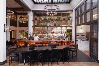 Studio Collective outfitted the double-height, soaring lobby space in the spirit of great European hotel bars.