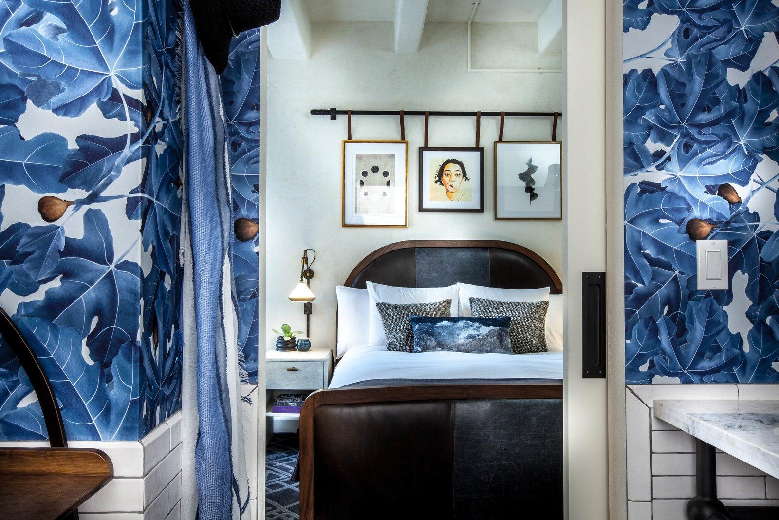 Hotel Figueroa bedroom with blue leaf wallpaper
