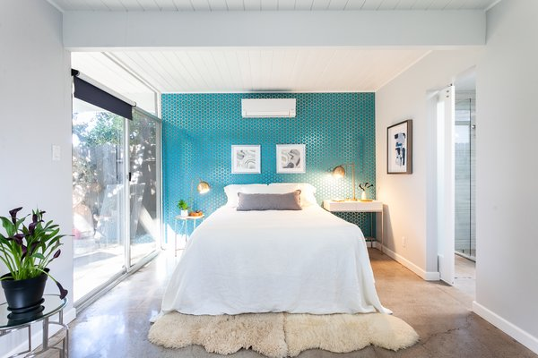 The master suite includes an updated ensuite bathroom and sliding doors which open to the backyard.