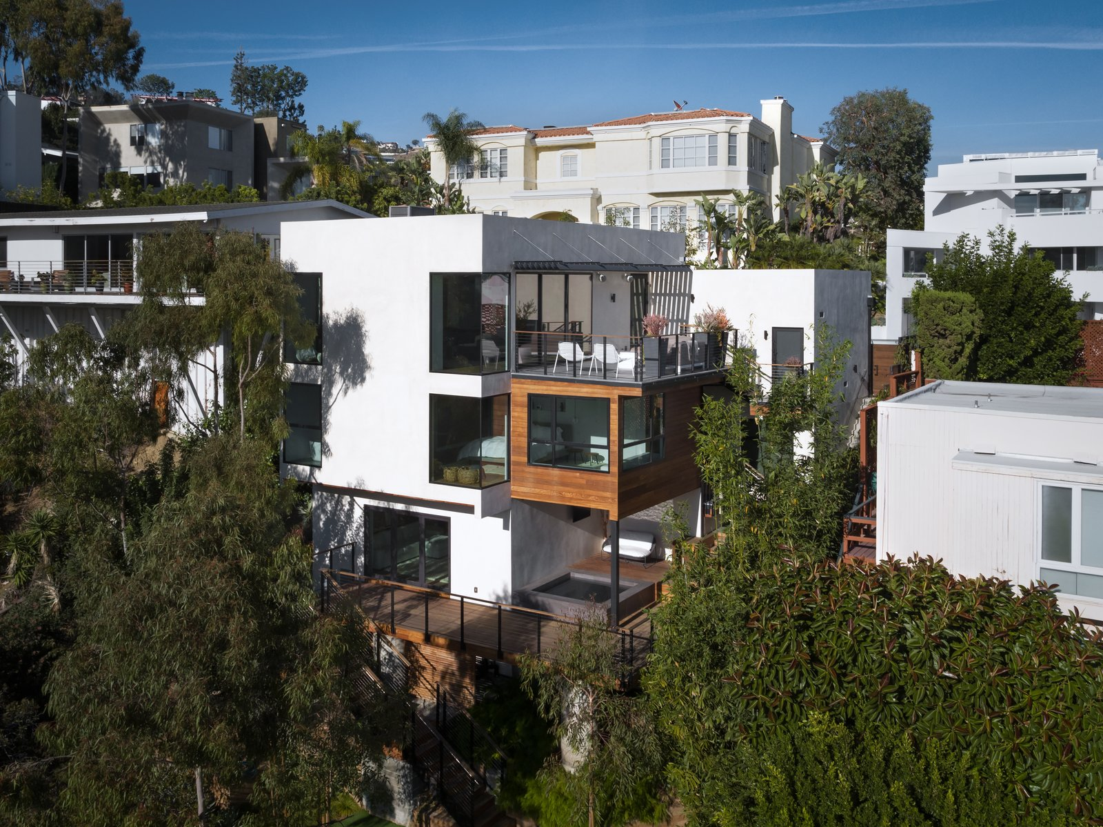 Exterior, House Building Type, Flat RoofLine, Wood Siding Material, and Stucco Siding Material A look at the multi-level home in the Hollywood Hills.   Photo 8 of 8 in Architect Abeer Sweis Shares Fire-Resistant Building Strategies