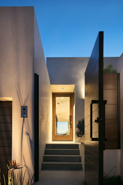 The home is clad in stucco, which is an extremely fire-resistant material. The front door is made from mahogany, which is durable and matches the gate.