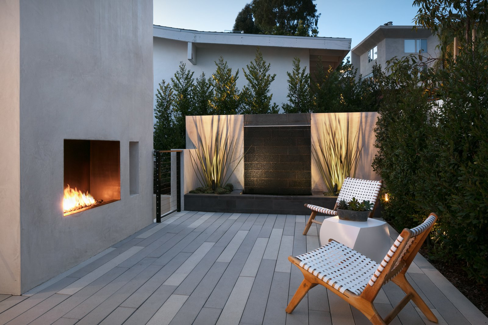 Outdoor, Rooftop, Small Patio, Porch, Deck, Stone Fences, Wall, Concrete Fences, Wall, Decking Patio, Porch, Deck, Trees, Shrubs, Wire Fences, Wall, and Horizontal Fences, Wall Sweis created a number of different outdoor spaces, each with its own feel.   Photo 6 of 8 in Architect Abeer Sweis Shares Fire-Resistant Building Strategies