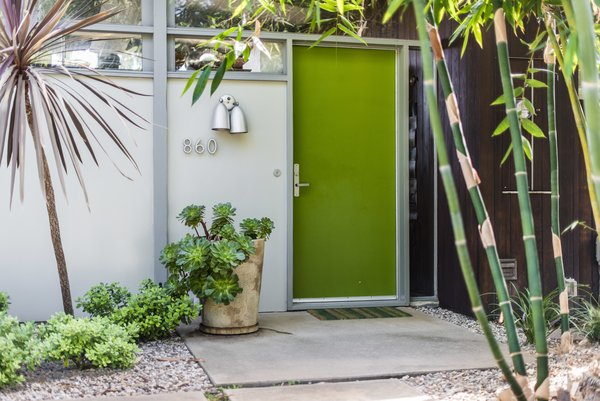 A bright green door pairs well with the surrounding foliage.