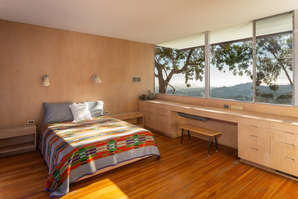 The master bedroom overlooks the stunning hillside scenery.