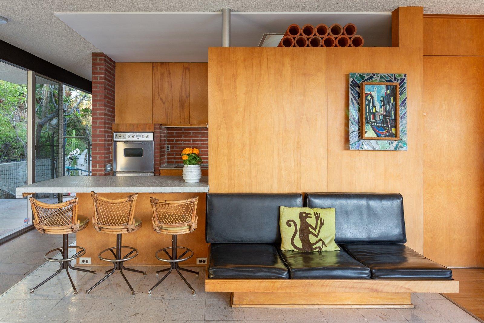 Midcentury modern Neutra home kitchen with breakfast bar