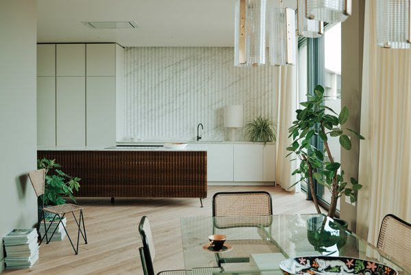 The light-filled kitchen elegantly integrates into the living space.