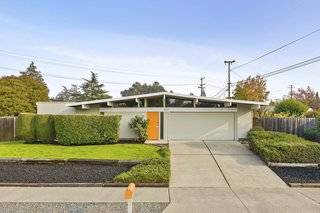 3767 Barrington Drive features a classic Eichler profile and an inviting bright orange front door.