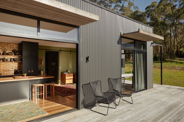 Positioned towards the north, raked ceilings and windows draw natural light into the living area, while eaves and awnings block the harsh summer sun.