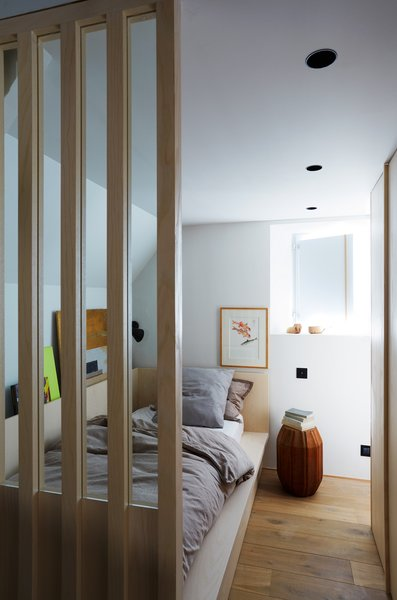 An upstairs bedroom nook. The wood slats help visually integrate the space with the lower level.