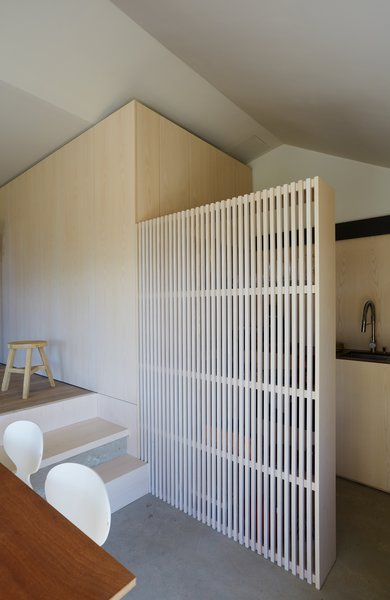 Wood slats divide the space while providing additional storage.