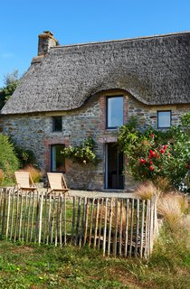 The facade of the cottage beautifully blends both past and present.