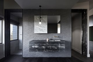 The minimalist bathroom provides a calm, introspective experience.