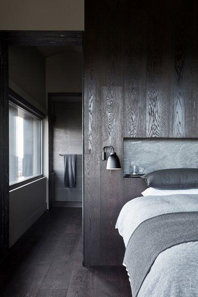 dark wood floor bedroom rug the minimalist material palette incorporates light and shadows into tonal textural mix best modern bedroom dark hardwood floors design photos and ideas dwell
