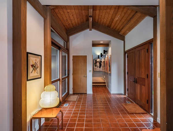 A tiled entryway sets the stage for the property's warm, light-filled interiors. The entrance leads directly to the living space.