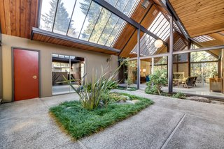 The double-gable atrium floods the home with natural light.