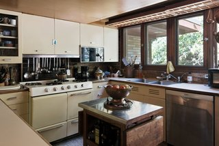 The original midcentury kitchen is in good condition, but could benefit from updates.